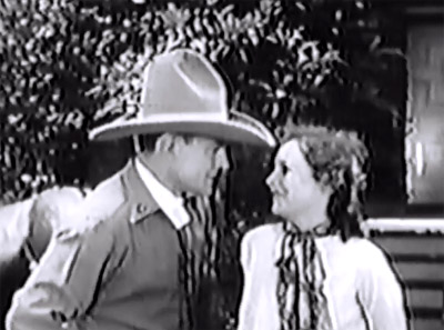 Roaring West--Buck Jones and Muriel Evans
