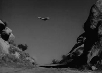 Adventures of Captain Marvel--glide through canyon
